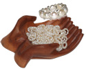 Pearl rigs in wooden hand bowl