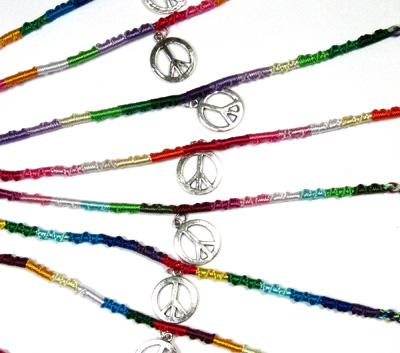 String friendship bracelet with peace sign charm