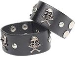 Wide black leather cuff bracelet with skull and crossbones