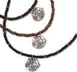 Wood beaded necklaces with pirate coin medallion pendants