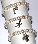 Natural pearl and seed bead stretch bracelet with assorted sea life charms