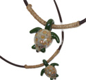 Glass turtle pendant on hemp wrapped rough leather thong necklace