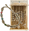 Cowrie and cat's eye tan string friendship bracelet display kit.
